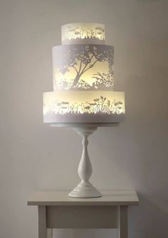 There is a 3 tier cake behind the translucent outer covering, and led tealights which create the glowing light
