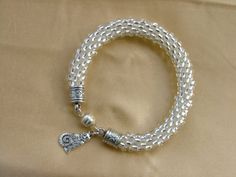 Clear Kumihimo bracelet with Silver clasp and cat charm on Etsy, $22.00