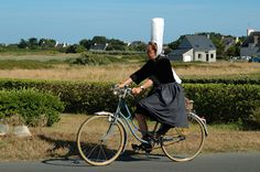 "Bigoudène à vélo | My father'aunts used to wear those ""coiffe"" when they came at home for diner."