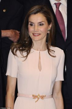 The 44-year-old cinched her pleated-skirt dress with a delicate dusty pink belt...