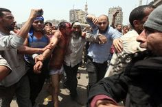 Khaled Elfiqi—EPA  May 2, 2012. Egyptian anti-military protesters arrest one of the rioters who attacked them, during clashes at Abbassiya Square, Cairo.