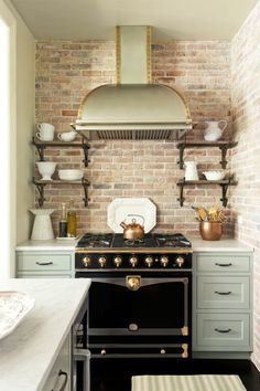 This light green color works well in any kitchen, but looks particularly great when paired with a light brick wall and black stove.