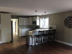 White cupboards, dark floor kitchen