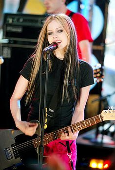 Avril Lavigne performs on stage during MTV's Total Request Live at the MTV Times Square Studios May 25, 2004 in New York City.