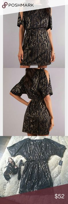 """🚨35% OFF BUNDLES 🎉 Jessica Simpson Dress Gorgeous dress with metallic accent from Jessica Simpson. Features wide crew neck , elbow length sleeves with cutout detail. Keyhole back with button closure, elasticized waist with self tie belt, sheer mesh overlay with metallic accent. Lined. Self and lining 100% Polyester. Approx. measurements: bust 24""""(unstretched), up to 31""""(stretched), hips 34"""", length shoulder to hem 34"""". Jessica Simpson Dresses"""