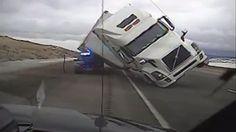 Terrifying dash cam video shows wind-blown semitrailer crush patrol car // AOL News