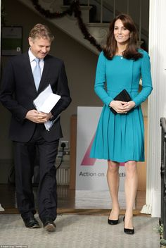 Kate, who looked resplendent in bold blue, is a patron of the charity, Action on Addiction...