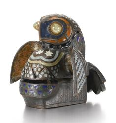Owl': A bronze and enamel box from the 'Enchanted Beasts' Series, Princess Maria Tenisheva, 1908 cast as a stylised owl with spreading wings, decorated with polychrome enamel geometric motifs, the eyes set with quartz cabochons within copper collets, the breast, head and wings forming the lid, the top of the tail feathers incised with monogram MT, stamped with date 1908 and number 6 width 15.5cm, 6 1/8 in.
