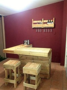 If you are looking for building a bar at your home and have low-budget then opt for this awesome DIY pallet wood bar. Nail the planks to build a counter top, strong and firm simply designed stools and rack to hold the glasses and bottles and look how beautiful and exotic bar it is.