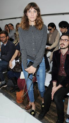 alexa chung's simple style- denim jeans and a grey sweater.