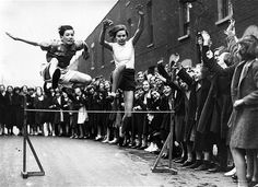 Street Hurdles, May 1936 East London Schools Hurdles champion Grace Adams races on the Poplar street track in preparation for the annual contest. Photography Exhibition, Photography Pics, Vintage Photography, Vintage London, Old London, Lake District Attractions, Accelerated Nursing Programs, Best Nursing Schools, Schools In America