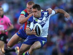 Josh Reynolds of the Bulldogs is tackled by Alex McKinnon of the Knights during the round 10 NRL match between the Newcastle Knights and the Canterbury Bulldogs at Hunter Stadium on May 19, 2013 in Newcastle, Australia.