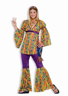 "Purple Haze Hippie Teen Costume Get psychedelic in purple this Halloween with this three-piece 60s hippie costume for teens.  This peace patterned tunic says ""peace and love"" all over it. With rainbow background, flowers and peace sign patterns the tunic is empire cut with a purple trim under the chest. A purple and yellow band trim the v-neck and arm bands on the bell sleeves that make the costume flow. #60s #teen #calgary #yyc #costume"