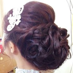This formal ready look features an elegant bun that consists of sectioned pinned curls and adorned by a rhinestone comb. See the amazing products used for inspiration.