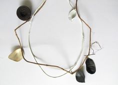 a 'sketch' for a necklace concept combining natural materials and pieces I've made