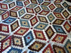 Work in the attic: Sewing hexagons diamonds.  So pretty!