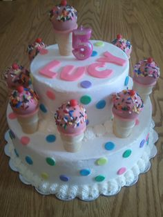 Cake pop ice cream cones and a birthday cake.