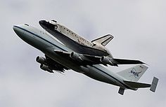 This amazing machine is flying for the last time. Friday morning  the shuttle Enterprise buzzed NYC on the back of a retrofitted 747, en route to permanent display at the Intrepid Sea, Air and Space Museum. Happy landings!    Read more: http://www.time.com/time/health/article/0,8599,2112732,00.html#ixzz1tFkGpocS