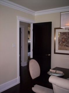 I like the trim in this....I would do tan walls, and a white door with dark hardware.