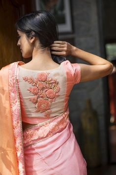 Hand embroidered pink blouse matched to a saree. Perfect for a big event.   Designer wear for Indian weddings.   Find more at www.jivaana.com.