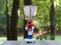 A personal favorite from my Etsy shop https://www.etsy.com/listing/252303752/vintage-irmi-toy-soldier-nursery-lamp