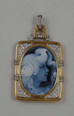 This carved stone cameo is exquisite, a wonderful example of modern portraiture in gemstone. The framed is equal to the artwork, as well! 18K Yellow