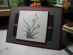 handmade card: contemplative artistry by tropduck  ... luv the formal look ... black, white and gray with red ink, ribbon and mat ... Asian Artisty ... piercing ... luv it!