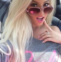 Love her glasses and all the pink! My fav!