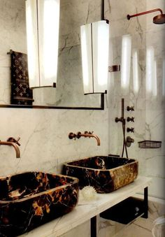 different material for sinks but this style - old school faucet on the wall, 2 sinks on a ledge.