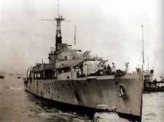 HMS 'Amethyst' about to come alongside the quay at Hong Kong Naval Dockyard - 10 August 1949