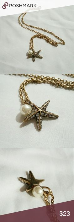 """Starfish pearl pendant necklace Stunning mermaid-chic necklace with starfish pendant bejeweled with tiny crystals and accented with a faux pearl, hanging from a sturdy bronze chain. Fantastic detailing and quality - very beautiful and elegant! Perfect summer beach surf style.  18"""" chain Wild Rose Boutique  Jewelry Necklaces"""