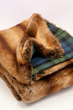 The perfect solution to a damp, chilly evening. Our Scot Meacham Wood Home Grendall Faux Fur Throw features lush faux fur reversing to classic Ancient Campbell wool tartan. Lush faux fur backed in wool Campbell Ancient tartan measurements X Tartan Throws, Tartan Plaid, Scottish Plaid, Ralph Lauren Style, Fur Blanket, Textiles, Faux Fur Throw, Plaid Christmas, House In The Woods