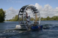 Chris Todd walks on water with the help of his self built 'tredalo'. He is attempting to walk across the Irish Sea in the contraption.