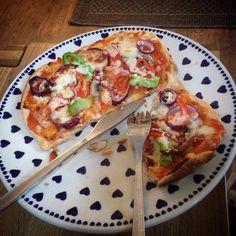 Homemade pizza on a beautiful Polish Pottery plate.