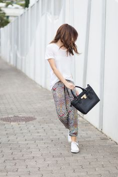 Cappuccino — Silver Girl - wearing printed pants from Stradivarius with a lightweight white t-shirt blouse and white taylor chuck converse, Michael Kors handbag. hot christmas outfit, street style, ootd, fashion.