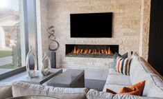 Gas burning, linear fireplaces from Isokern offer a stylish way of modernizing your space. Head over to earthcore.com to get started on your project... Linear Fireplace, Custom Fireplace, Gas Fireplace, Installation Manual, Colored Glass, North America, Indoor Fireplaces, Modern, Design