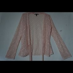 Victoria Secret lace wrap shirt Beautiful detailed lace shirt.  It look sender full with everything. Just getting away from lace. Perfect condition. Pale pink. Victoria's Secret Tops Blouses