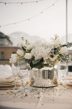 Photo: Brooke Shultz Photography; Love this sweet little wedding centerpiece with white tulips!