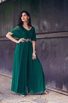 Bottle green pleated jumpsuit with sparkling cutdana stones complementing the entire look along with sheer sleeves. Indian Fashion Dresses, Indian Gowns Dresses, Dress Indian Style, Indian Designer Outfits, Designer Dresses, Fashion Outfits, Maxi Outfits, Designer Wear, Formal Dresses