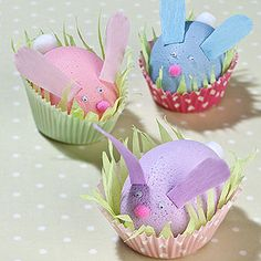 Bunny Eggs  Paint polystyrene eggs.  Glue white pom pom for tail, paper ears, googly eyes and pink pom pom nose.  Shred green crepe paper and place in cupcake case with decorated bunny egg.