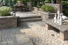 multi level patio with stone bench