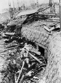 9 August 1945 - A tram, top center, is flattened in its rails and its passengers flung dead in a ditch, following the detonation of the atomic bomb over Nagasaki - Photographed 1 September 1945