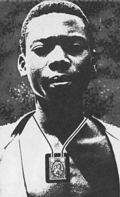 """Blessed Isidore Bakanja had a great love for the Blessed Virgin Mary that he expressed through praying the Rosary and faithfully wearing the Brown Scapular of Our Lady of Mount Carmel. His refusal to abandon his practices, in particular the scapular of the Virgin, so infuriated his supervisor that he was beaten streaming with blood and placed in solitary confinement with chains. He died from his wounds but forgave his tormentor, declaring """"When I am in heaven, I shall pray for him very…"""