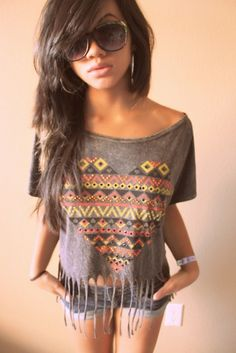 buy thrift store shirt. Cut off the neckline. Iron on a cute print. Fringe the bottom. <3