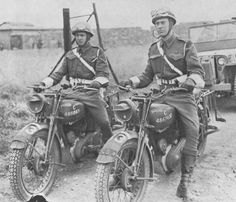 """Canadian Army Norton motorcycles overseas in Europe during WWII with WD numbers on the petrol (gas) tanks). Numbers C4866931 and C4867430. The """"C"""" is the code letter for motorcycle. Usually Canadian vehicles had an extra C added in front - for Canada."""