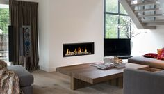 Victoria Stone supply a wide range of contemporary gas fires that can form a stunning centrepiece to your room. We can provide a huge range of sizes and styles, from gas fires to fit inside a traditional fireplace surround to more contemporary gas fire. Inset Fireplace, Modern Fireplace, Living Room With Fireplace, Fireplace Surrounds, Fireplace Design, Stone Fireplaces, Fireplace Ideas, Living Room Modern, Home And Living