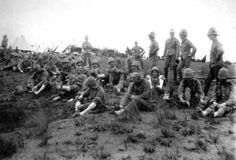 After a long days march through the rough South African countryside, the King's Royal Rifles check their feet for 'wear and tear'. (McGregor Museum)