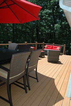 This red deck furniture really sets the Trex Brasilia Burnished Amber decking off nicely!     check us out:  http://stainlesscablerailing.com/