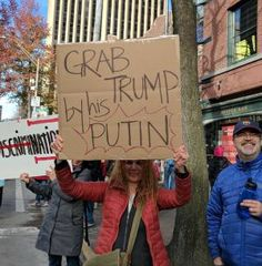 Clever and biting protest signs from the Women's March on Washington and sister marches around the world.: Grab Trump by His Putin