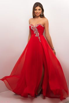 prom dress in chiffon! Stunning elegance as jewels, stones and embroidery assymetrically drape your bust and flow into a full chiffon dance gown.